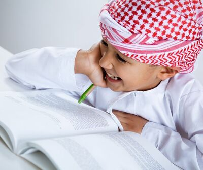 Arab Boy Reading