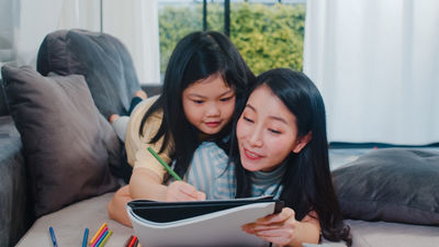 asian woman and her daughter