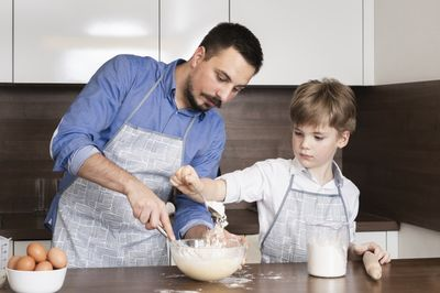 male teacher and child having a cooking class