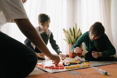 boys playing a board game